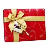 Boîte 38 chocolats assortis emballée papier Noël et ruban