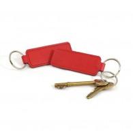 Porte clé logoté languette en cuir